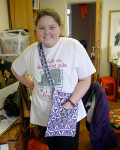 Look it has a pocket! Elizabeth and her finished tote.